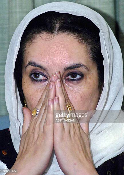 File picture taken 22 October 2007 shows former Pakistani prime minister Benazir Bhutto praying with unseen Sunni Muslim party leaders in Karachi in...