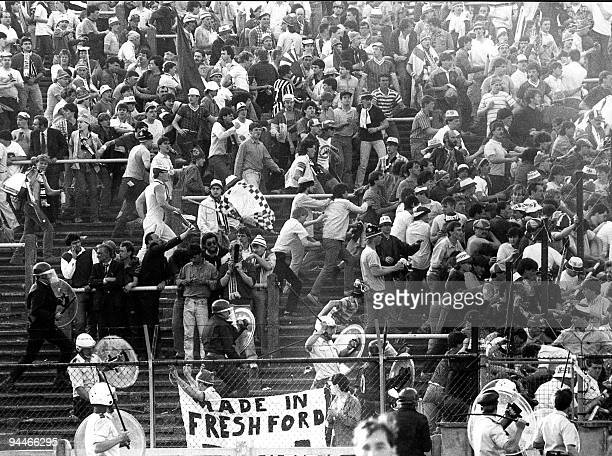 A file picture taken 29 May 1985 in Brussels shows riots at the Heysel football stadium during the European Cup final between Britain's Liverpool and...