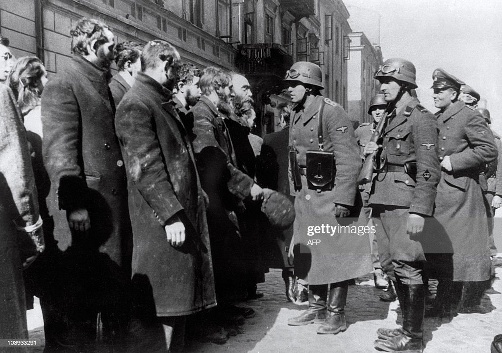 File picture taken in 1943 of Nazi German soldiers questioning Jews after the Warsaw Ghetto Uprising. In October 1940, the Nazis began to concentrate Poland's population of over 3 million Jews into overcrowded ghettos, in which the largest of these, the Warsaw Ghetto, where thousands of Jews died due to rampant disease and starvation, even before the Nazis began their massive deportations from the ghetto to the Treblinka extermination camp. In 1943 the Warsaw Ghetto was the scene of the Warsaw Ghetto Uprising, the first urban mass rebellion against the Nazi occupation of Europe, which took place from 19 April until 16 May 1943, and began after German troops and police entered the ghetto to deport its surviving inhabitants. It ended when the poorly-armed and supplied resistance was crushed by German troops under the command of SS-Gruppenführer Jürgen Stroop.