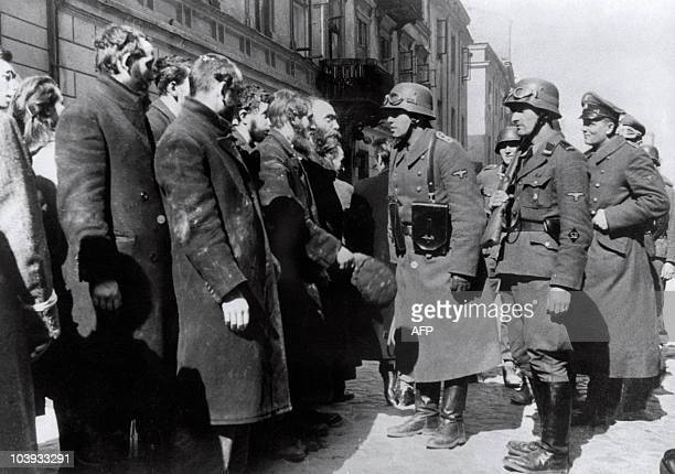 File picture taken in 1943 of Nazi German soldiers questioning Jews after the Warsaw Ghetto Uprising. In October 1940, the Nazis began to concentrate...