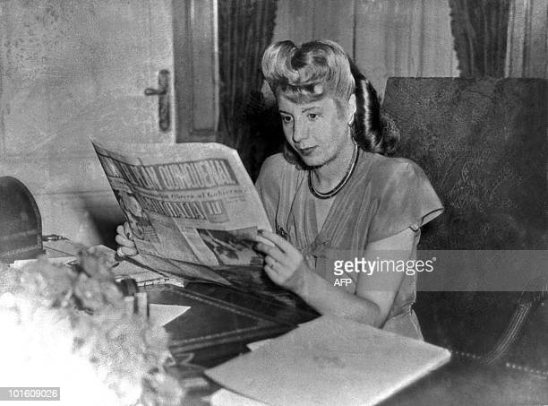 File picture taken in 1947 showing Eva Peron reading a newspaper Eva Peron known as Evita the second wife of Argentine President Juan Peron was a...