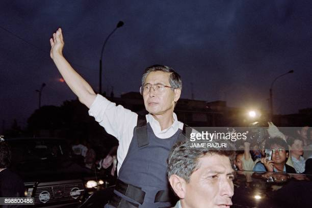 A file picture taken on April 22 1997 shows Peruvian President Alberto Fujimori waving as he leaves the residence of the Japanese ambassador in Lima...