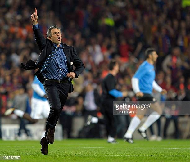 A file picture taken on April 28 2010 shows Inter Milan's Portuguese coach Jose Mourinho as he jubilates after winning the UEFA Champions League...