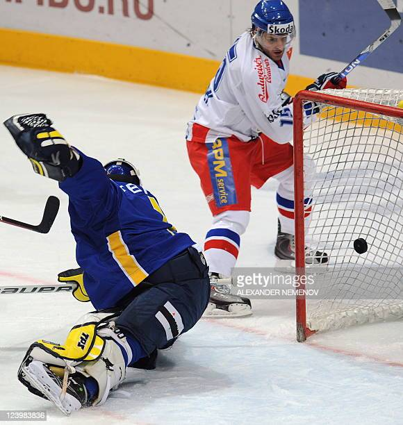 File picture taken on December 19 2009 of Czech Jan Marek attacking Swedish goalie Stefan Liv during the Channel One Cup the third event of the Euro...