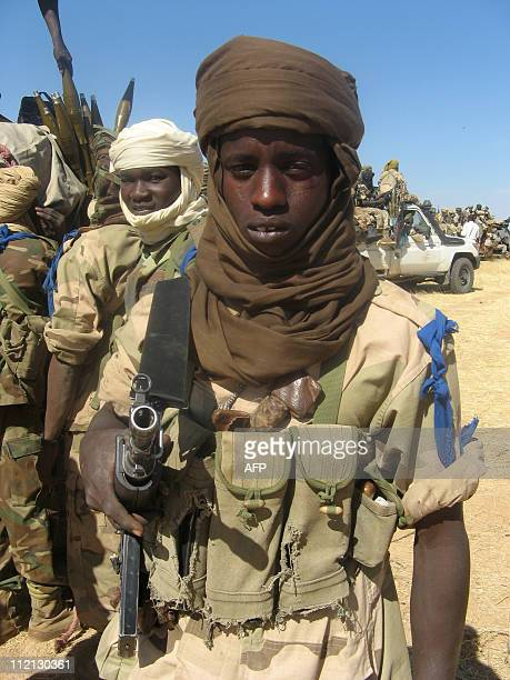 A file picture taken on December 6 2007 shows Chadian soldiers milling around near vehicles south of the Kapka mountain range in the east of the...