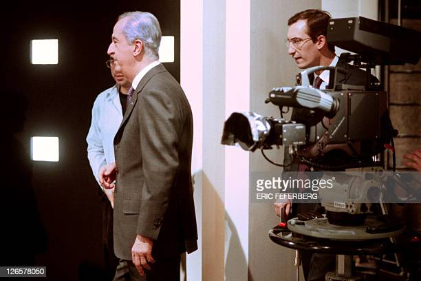 A file picture taken on February 2 1995 in Parisshows French Prime Minister Edouard Balladur arriving on a set of French TV channel TF1 followed by...