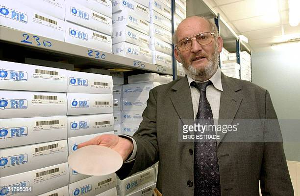 A file picture taken on January 17 2001 in La SeynesurMer southern France shows the President of Poly Implant Prothese JeanClaude Mas holding a...