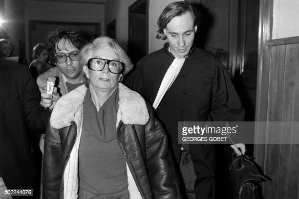 A file picture taken on January 20 1986 shows Fernande Grudet also known as Madame Claude walking with her lawyer Bruno Simonetta at the Court of...