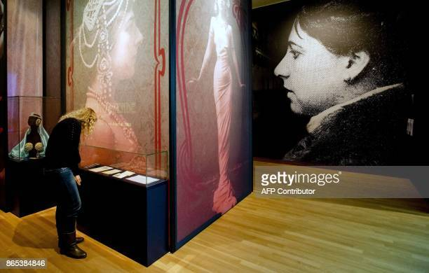 A file picture taken on January 28 2014 shows a woman visiting an exhibition dedicated to exotic dancer and suspected double agent Margaretha Zelle...