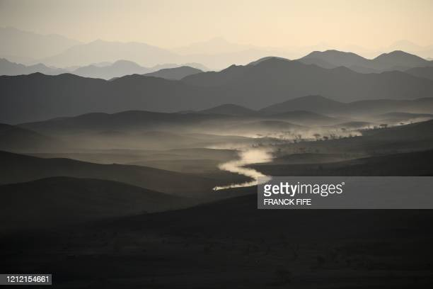 File picture taken on January 6, 2020 during the Dakar 2020 car racing shows a general view of Saudi Arabia's northwestern region, between Neoam and...