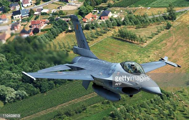 File picture taken on July 16, 2010 shows a Belgian air force's F-16 fighter jet during a rehearsal flight for the national parade in Florennes....