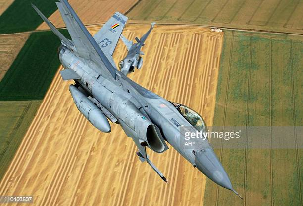 File picture taken on July 16, 2010 shows two Belgian air force's F-16 fighter jets during a rehearsal flight for the national parade in Florennes....