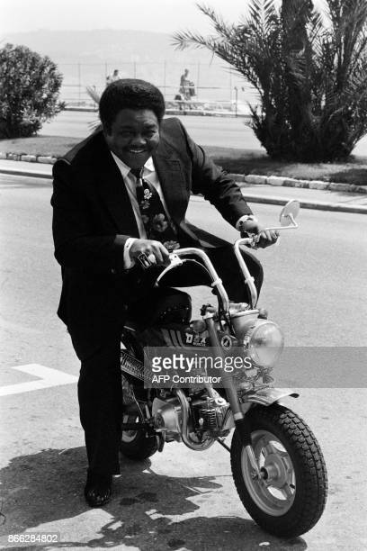 A file picture taken on July 18 1980 shows US pianist and singersongwriter Fats Domino posing on a Dax Honda motorbike during the 7th edition of the...