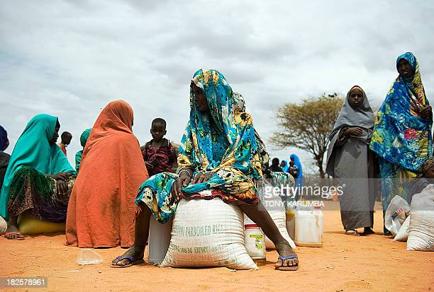 A file picture taken on July 18 2012 shows Somali women sitting with their rations after receiving relief food during a distribution excercise at an...