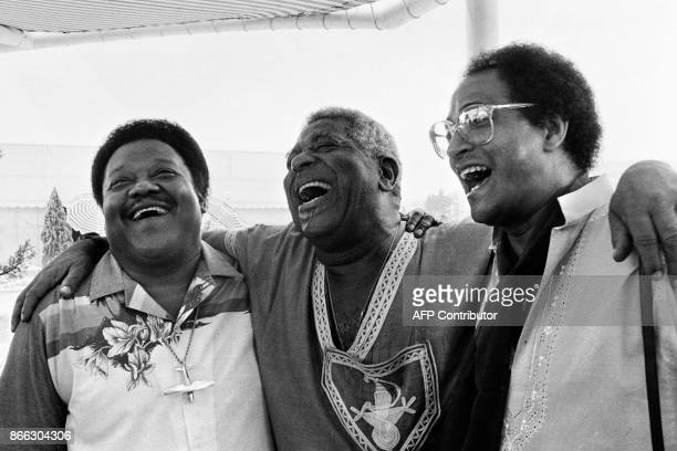 A file picture taken on July 20 1985 shows US pianist and singersongwriter Fats Domino standing next to US jazz musicians Dizzy Gillespie and Jimmy...
