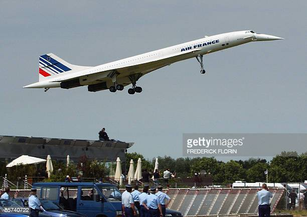 A file picture taken on June 14 2003 shows French Air France supersonic plane Concorde preparing for its last landing looked by French policemen at...