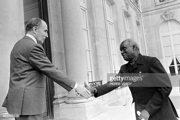 A file picture taken on March 28 1983 shows French President Francois Mitterrand shaking hands with Zambian President Kenneth Kaunda as he welcomes...