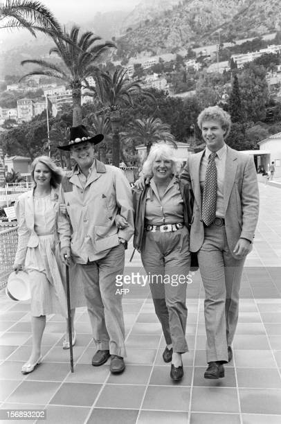 A file picture taken on May 4 1982 in Monaco shows US actor Larry Hagman of the TV series Dallas posing with his wife Mag and children Heidi and...