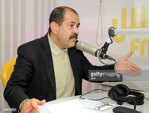 A file picture taken on November 20 2012 shows Tunisian lawyer and opposition leader Chokri Belaid speaking during a radio interview in Tunis Chokri...