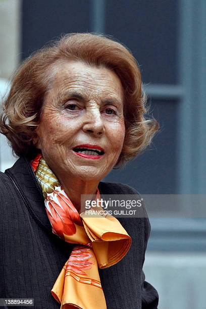 A file picture taken on October 12 2011 shows French Billionaire L'Oreal heiress Liliane Bettencourt leaving the Institut de France in Paris The...