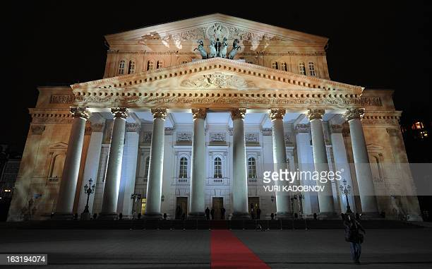 A file picture taken on October 28 shows people standing in front the Bolshoi Theatre in Moscow Bolshoi Ballet soloist Pavel Dmitrichenko and two...