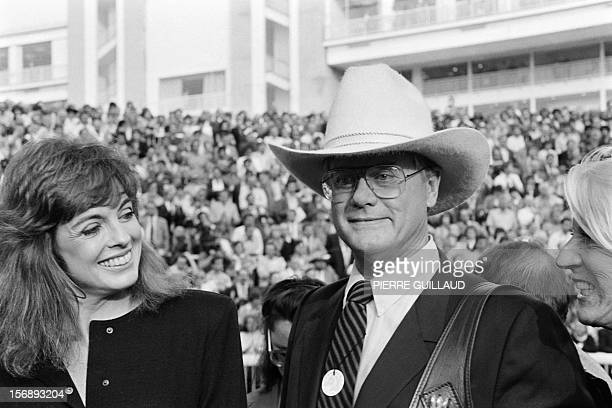 A file picture taken on October 5 1986 in Paris shows US actors Larry Hagman and Linda Gray of the TV series Dallas attending the Arc de Triomphe...