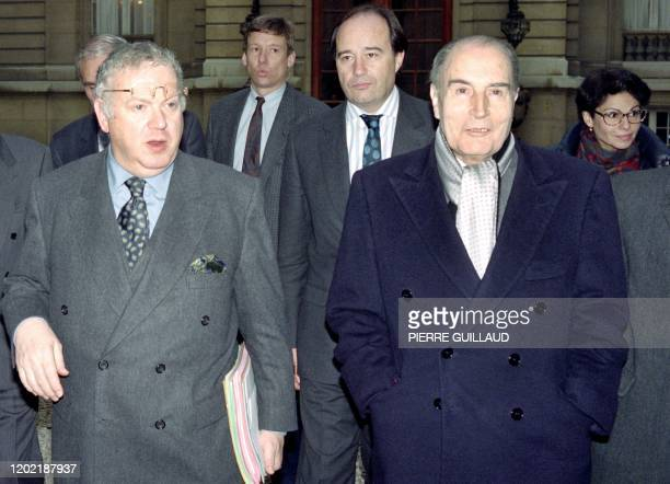 A file picture taken on on December 16 1992 shows French President Francois Mitterrand leaving a cabinet meeting held at the Prime minister residence...