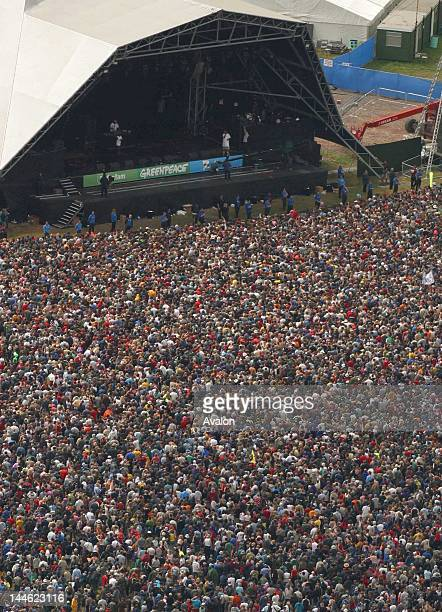File pictures of the Glastonbury Festival Picture shows aerial view of the 2004 festival with fans in front of the pyramid stage
