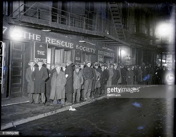 Filed 1/1930 New York NY Down and Outs and unemployed wait on a bread line for handouts at the Rescue Society Doyers Street Mission in Chinatown...