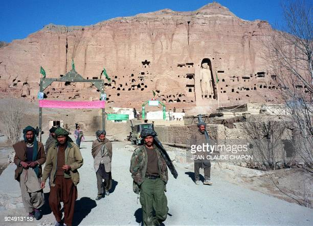 A filer picture dated 07 December 1997 shows soldiers belonging to Shiite faction HizbiWahdat on patrol in front of a hill with the ancient Bhuddha...