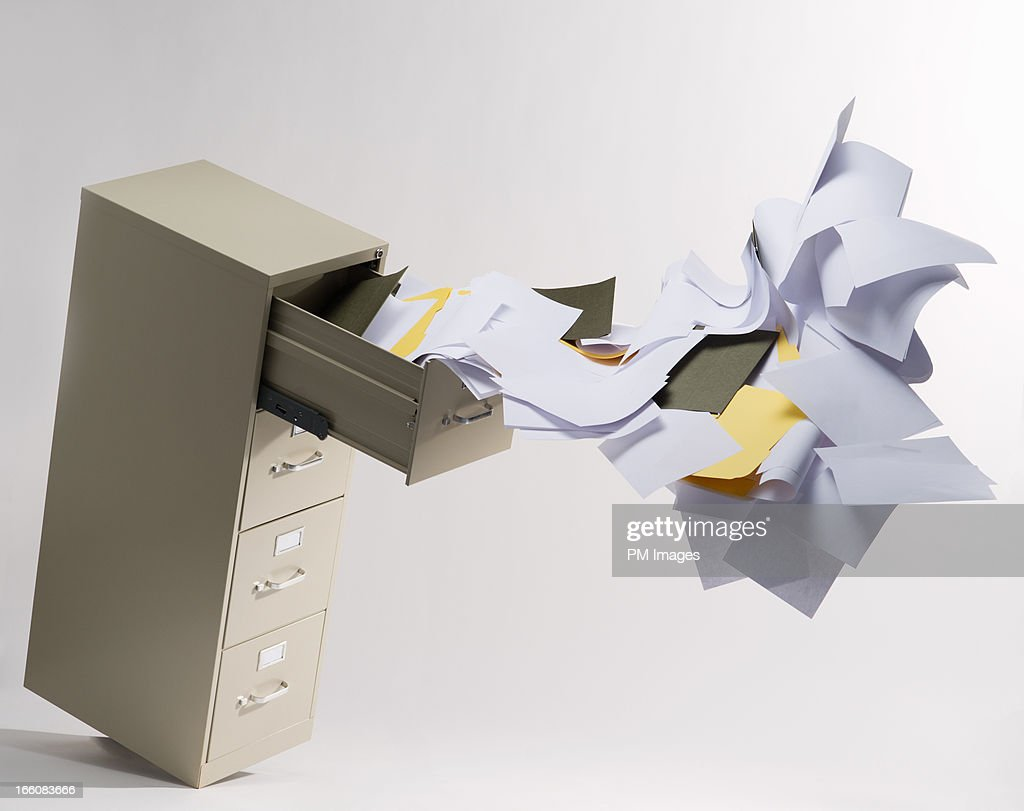 Files flying out of file cabinet : Stock Photo