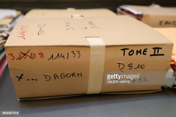 Files in the case of Patricia Dagorn a woman suspected of being a serial poisoner trapping wealthy widowers from the Cote d'Azur are pictured prior...