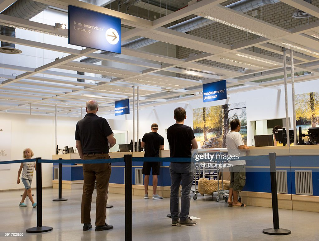 Filiale Of The Swedish Furniture House IKEA In Cologne. Customers At The  Counter For Service