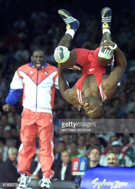 Filiberto Azcuy of Cuba celebrates his gold medal victory over Japan's Katsuhiko Nagata in the men's 69kg GrecoRoman wrestling final at the XXVII...