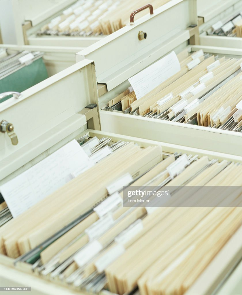 Filing cabinet drawers, close-up : Stock Photo