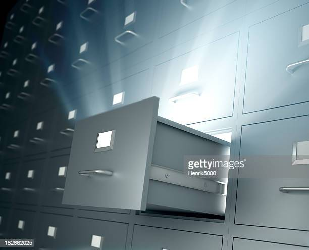 Filing cabinets, one open drawer emitting light