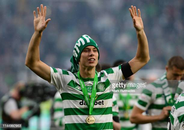Filip Benkovic of Celtic celebrates with the team as they win the league during the Ladbrokes Scottish Premiership match between Celtic FC and Heart...