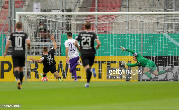Filip Bilbija of FC Ingolstadt 04 scores the first goal during the DFB Cup first round match between FC Ingolstadt 04 and Erzgebirge Aue at Audi...