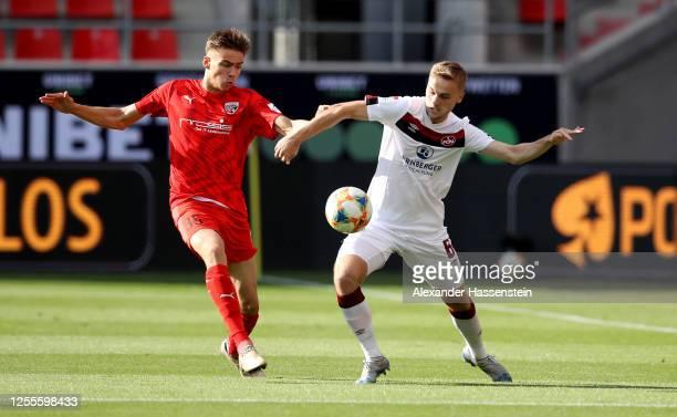 Filip Bilbija of Ingolstadt challengess Tim Handwerker of Nuremberg during the 2. Bundesliga playoff second leg match between FC Ingolstadt and 1. FC...