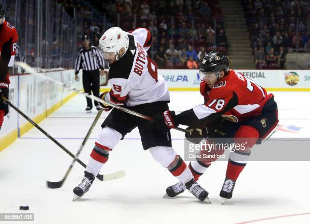 Filip Chlapik of the Ottawa Senators backchecks against Will Butcher of the New Jersey Devils during Kraft Hockeyville Canada on September 25 2017 at...