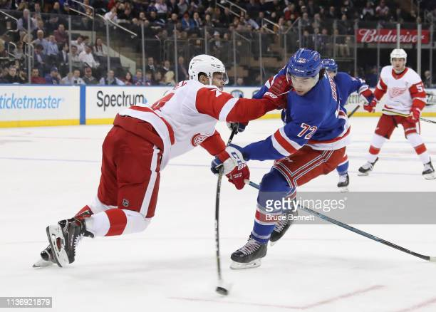 Filip Chytil of the New York Rangers gets off the second period shot while being checked by Madison Bowey of the Detroit Red Wings at Madison Square...