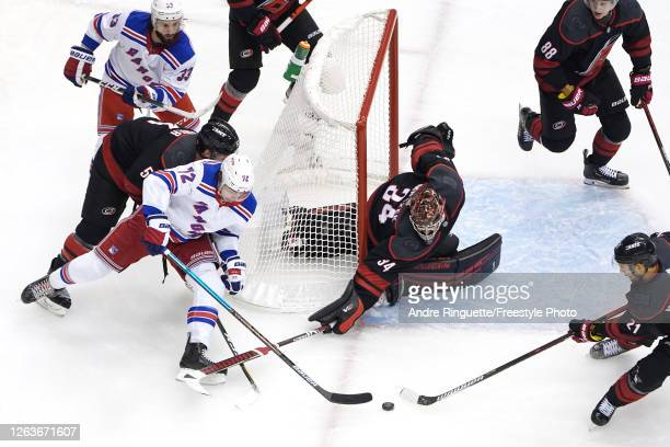 Filip Chytil of the New York Rangers looks for a shot against Petr Mrazek of the Carolina Hurricanes in Game Two of the Eastern Conference...