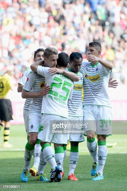 Filip Daems of Borussia Moenchengladbach celebrates with teammates after scoring his team's first goal during the Telekom Cup 2013 semifinal match...