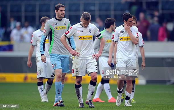 Filip Daems of Moenchengladbach and his team mates are looking dejected after loosing the Bundesliga match between Borussia Moenchengladbach and 1899...