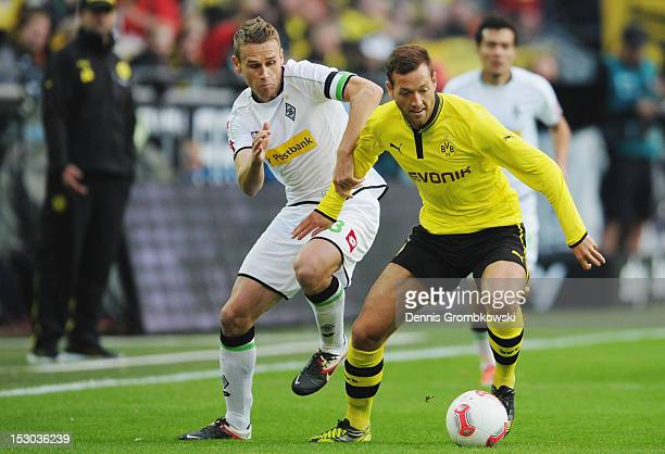 Filip Daems of Moenchengladbach and Julian Schieber of Dortmund battle for the ball during the Bundesliga match between Borussia Dortmund and VfL...
