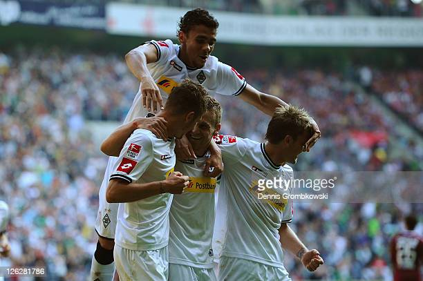 Filip Daems of Moenchengladbach celebrates with team mates after scoring his team's opening goal during the Bundesliga match between Borussia...