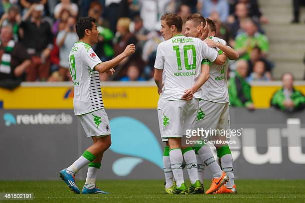 Filip Daems of Moenchengladbach celebrates with team mates after scoring his team's first goal during the Bundesliga match between Borussia...