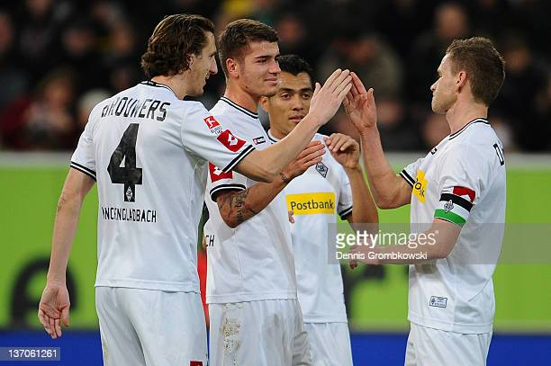 Filip Daems of Moenchengladbach celebrates with teammates after scoring his team's opening goal during the Stadtwerke Duesseldorf Wintercup 2012...