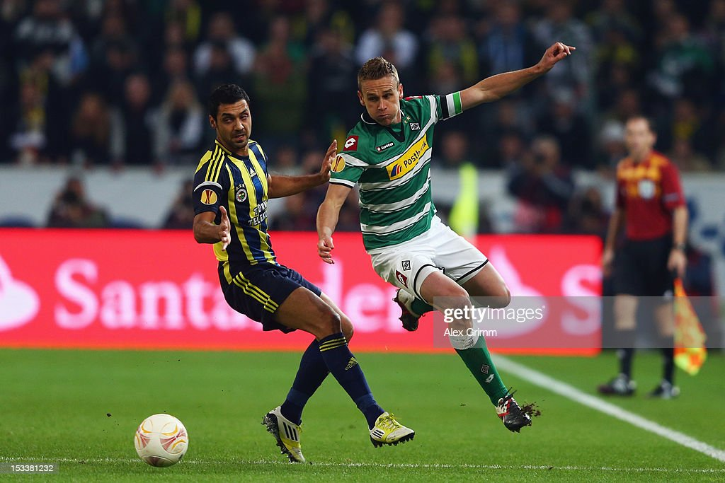 Filip Daems (R) of Moenchengladbach is challenged by Bekir Irteguen of Fenerbahce during the UEFA Europa League group C match between Borussia Moenchengladbach and Fenerbahce SK at Borussia-Park on October 4, 2012 in Moenchengladbach, Germany.