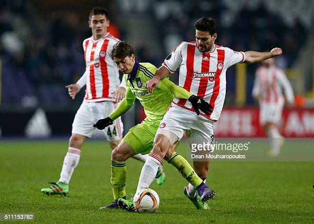 Filip Djuricic of Anderlecht and Alberto Botia of Olympiacos compete for the ball during the UEFA Europa League round of 32 first leg match between...